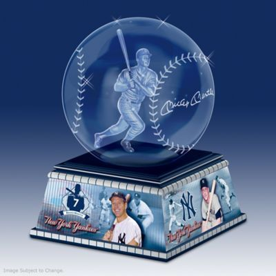 Limited edition! Optically pure glass baseball with 3-D laser-etched image of Mickey Mantle, replica signature. Base with portraits, stats, and logos.