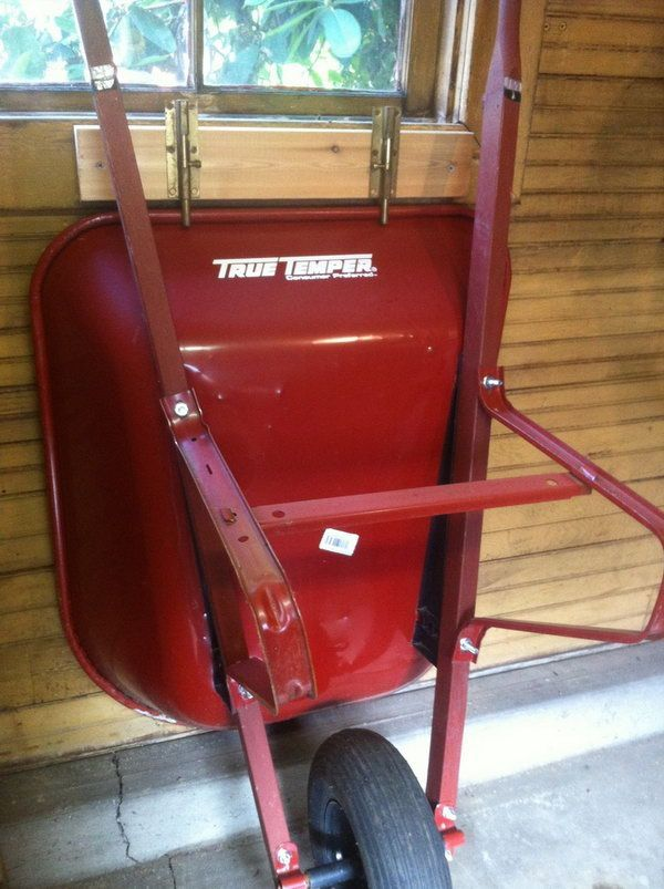 Use sliding locks to keep your wheelbarrow standing up against the wall and out of the way. http://hative.com/clever-garage-storage-and-organization-ideas/