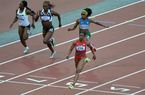 Carmelita Jeter 100-Meter Time | Carmelita Jeter crosses the finish line first in her 100-meter ...