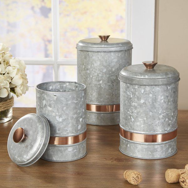 This industrial canister stays polished with a coppered band. Perfect for storing coffee grounds, bathroom essentials, and seashells alike.