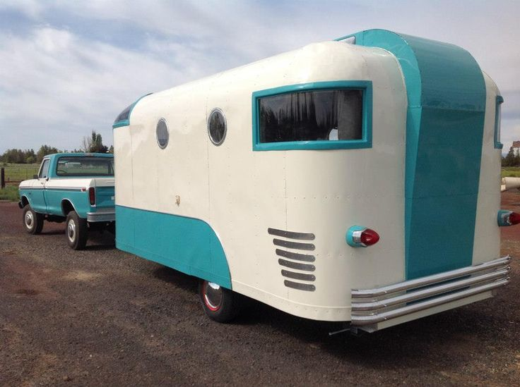 I love the matching colors on the truck and trailer and I really love the port hole windows, curved windows and decorative what-cha-ma-call-it in the middle.