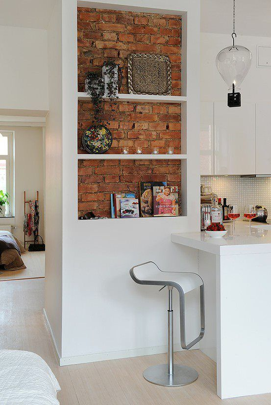 Work with what you've got. If you'd like to feature partially-exposed brick on a smaller scale, consider turning the structure into a clean and stylish display shelf.