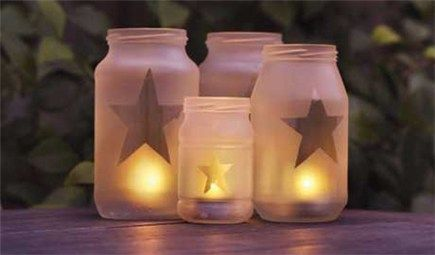 glass jar lanterns    1. Make a template out of card and use it to draw on the reverse side of the sticky-backed plastic. Cut out the plastic shapes and carefully stick them on to clean glass jars.  2. Spray the jars quickly and evenly with glass-frosting spray. Once fully dry, carefully remove the plastic to reveal the clear glass shapes.