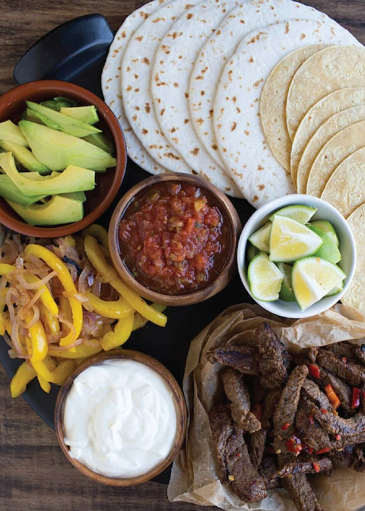 Spicy Margarita Beef Fajitas — Sirloin strips marinated in lime juice, chilies, garlic, and tequila? Delicious! Grill em' up, mix in grilled veggies, wrap it all in tortillas, and top with avocado and salsa for a fresh new lunch or dinner.