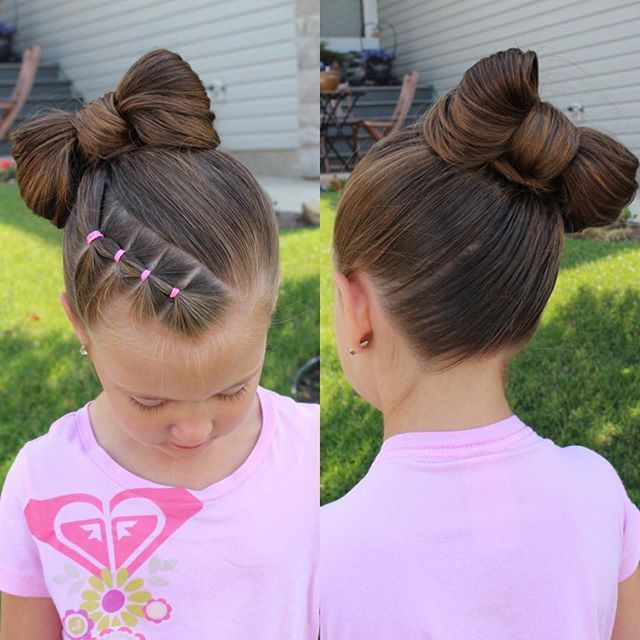 A simple bow with little elastic ponytails at the front.