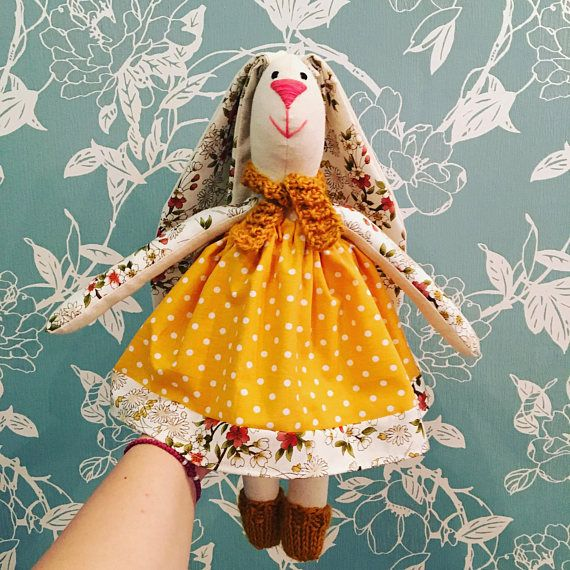 The Bunny is 100% handmade. All her clothing is either handknitted by me.  Finished Size: 41cm (16 inches) from table to top of head. Ear are about 35 cm (14 inches) Materials: linen, cotton fabrics, wool for knitwear. All pieces of clothes can be removed. You can also order