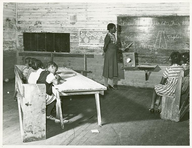 Interior of school on Mileston Plantation; School begins very late in the year and attendance is poor until December because the children pick cotton, Mileston, Mississippi Delta, Mississippi, November, 1939.. Wolcott, Marion Post -- Photographer.