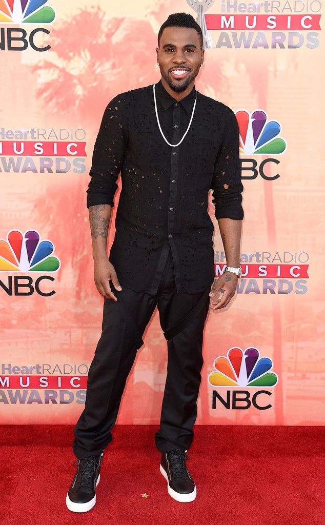 He's riding hole-o! Jason Derulo wears an, er, airy button-down with mesh pants on the iHeartRadio Music Awards red carpet.