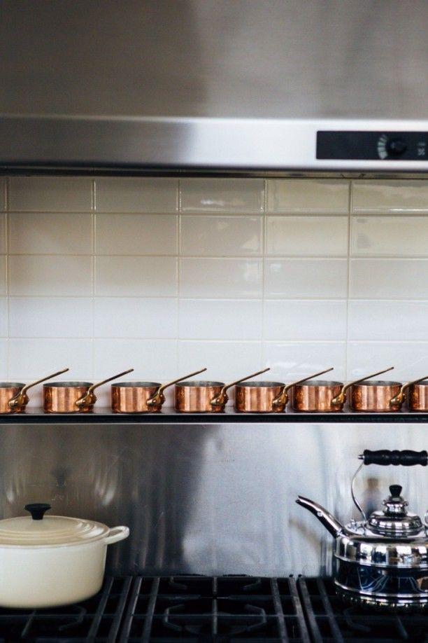 Joan-McNamara-LA-loft-stove-with-copper-pans-ljoliet-Remodelista