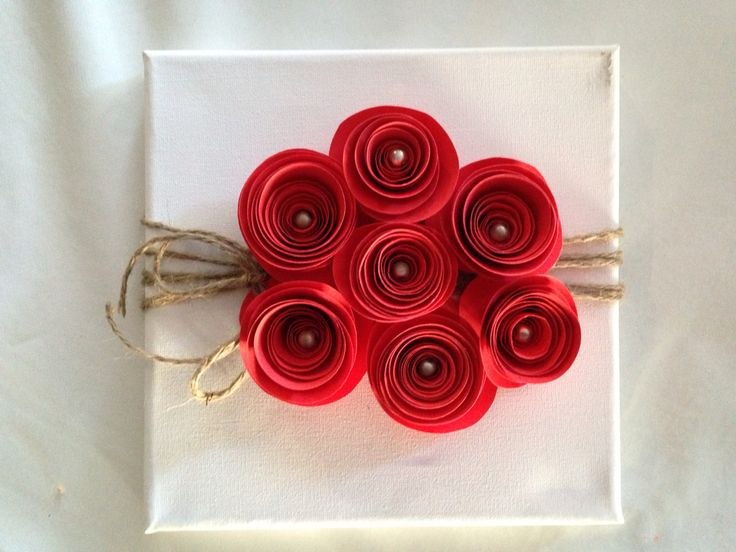 Red paper flowers on canvas