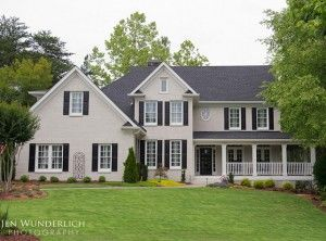 "Exterior Paint Colors. ""Benjamin Moore Vanilla Milkshake"" and brick is ""Benjamin Moore Revere Pewter""."