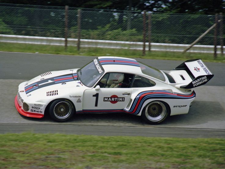 Sideview of Rolf Stommelen's 1976 Works-Porsche 935 in the distinctive Martini colours