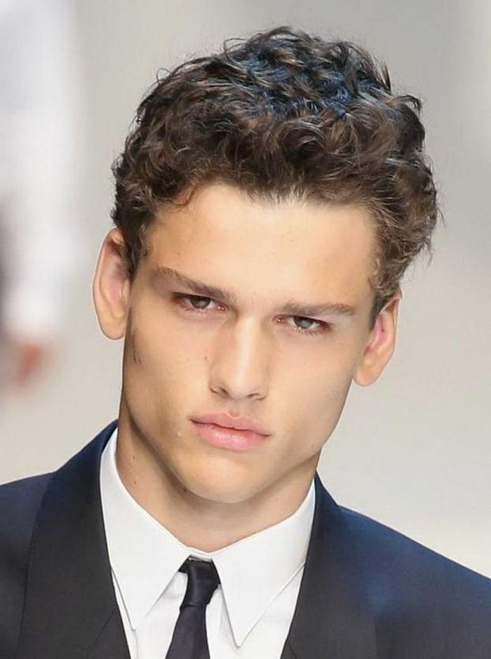 Very Serious Young Man, With Short Curly Brunette Hair