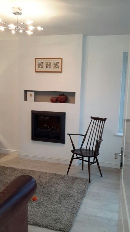 Inset Dimplex electric fireplace, so pleased how it has changed a new build boxy room into a home. Cosy place to sit in Ercol goldsmith chair.
