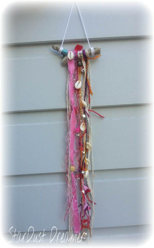 Bohemian Bell Chain Hanging 2 Boho wooden driftwood hanging with silver bell chain for clearing negative energy. White wool hanger with shell chain, crystals, pompom wool, fabric and lace. Perfect size to hang on bedroom door handle.