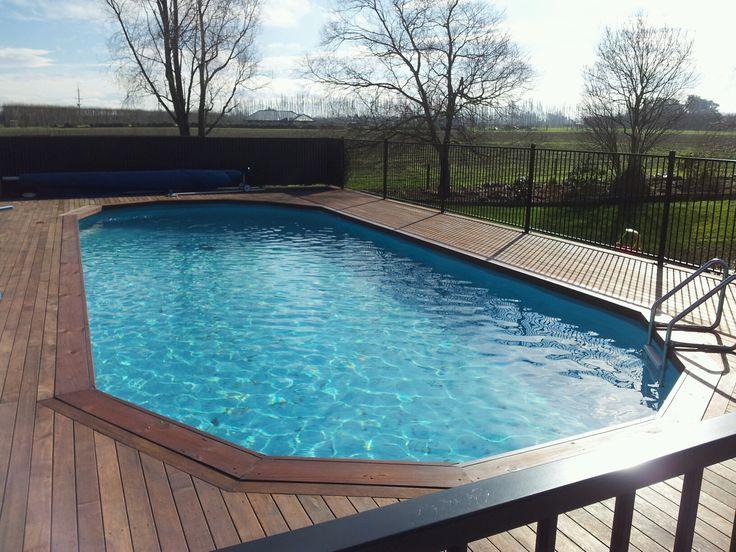 Various Semi Inground Pools To Inspire Your Exterior Design Ideas: Fascinating Semi Inground Pools With Wood Flooring