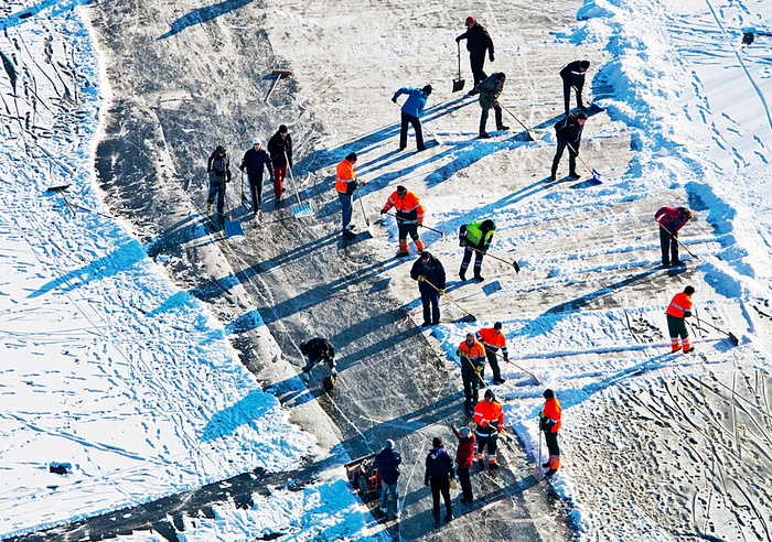 People working hard to prepare the ice for the ...
