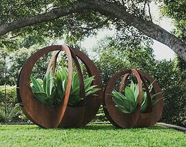 Stunning outdoor garden sculptures of Corten steel encasing agave attenuata. Broadcroft Design Creative Metaworks, Queensland, Australia. http://www.broadcroftdesign.com/outdoor-art https://shop.cacti.com/landscape-succulents/agave-attenuata/ #SerraGardens_agave_attenuata
