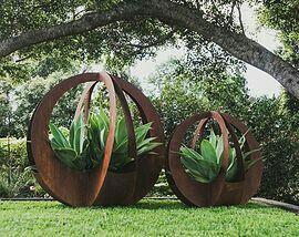 Stunning outdoor garden sculptures of Corten steel encasing agave attenuata. Broadcroft Design Creative Metaworks, Queensland, Australia. http://www.broadcroftdesign.com/outdoor-art https://shop.cacti.com/landscape-succulents/agave-attenuata/ #SerraGardens_agave_attenuata