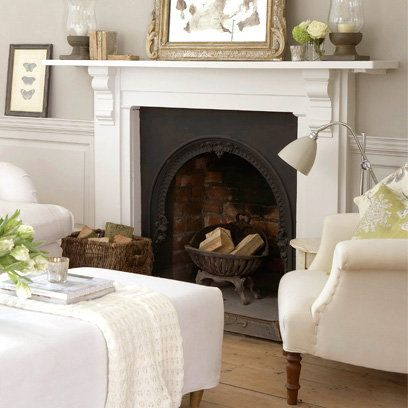 Contemporary country living room, white panelled fireplace