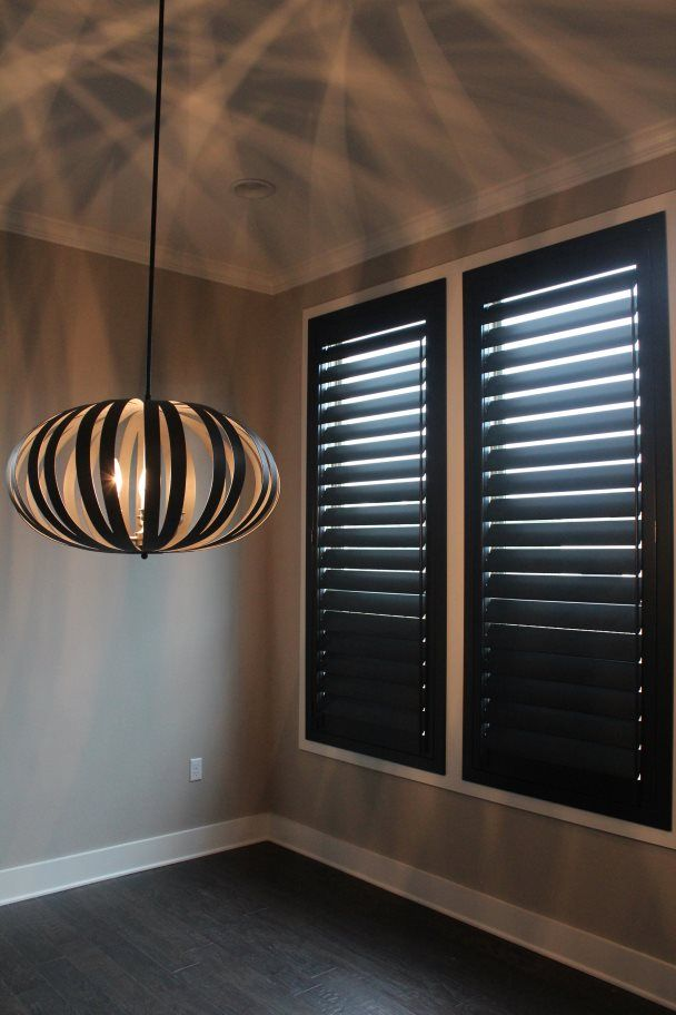 Our new black plantation shutters in the dining room. Austin Window Fashions.