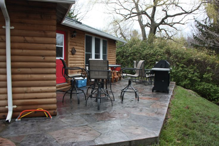 A old concrete patio that Hickory Dickory Decks put Flex-C-Ment over to make look like flagstone.