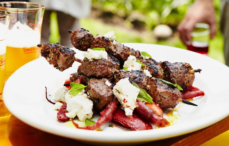 Marinated, grilled, and paired with tender carrots and a simple feta-mint condiment, these lamb skewers are the answer when you're looking for big flavor. For the most tender results, use meat cut from the top round of the leg of lamb, or trim around the connective tissue of a butterflied leg to get to the leaner meat.