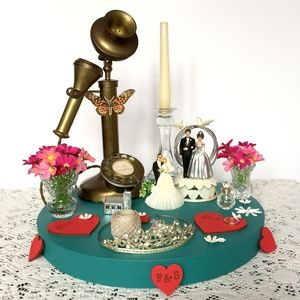 Vintage wedding table centrepiece from The Fabulous Vintage Bride