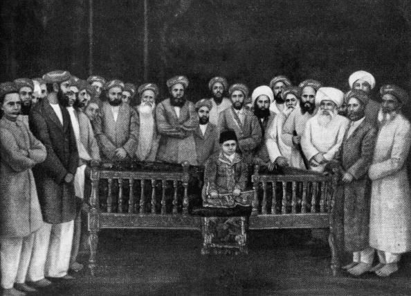 The 7-year-old Aga Khan III (1877 - 1957) at his enthronement ceremony as Imam of the Shia Ismaili Muslims in Bombay, 1st September 1885. He is surrounded by community elders and seated on the oblong wooden throne of imamate. (Photo by Keystone/Hulton Archive/Getty Images) Imam Aga 'Ali Shah Aga Khan II was succeeded by Imam Sultan Muhammad Shah Aga Khan III, who became the new Imam at the tender age of 7 years. Upon his installation, many of the members of the Community were distraught and…