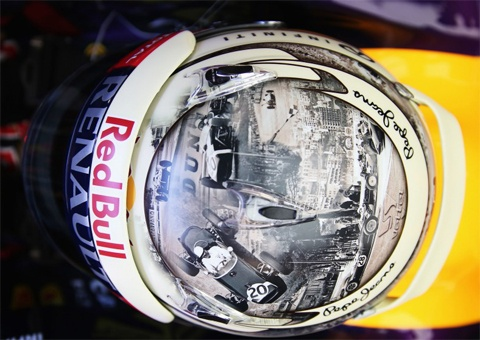 Sebastian Vettel helmet featuring Sir Stirling Moss's spectacular 1961 drive through.