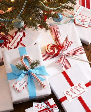 Love the idea of putting candy canes on top of presents. // 100 days of Christmas!