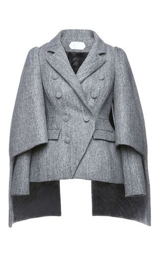 This **Dice Kayek** coat, rendered in virgin wool, features long sleeves with cape-style overlay, a double-breasted button front, and a notched collar.