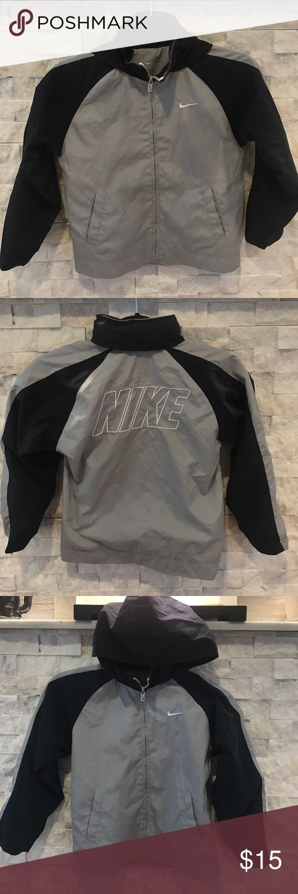Nike Windbreaker Nike Windrunner Navy/gray colorway perfect for fall. Includes stow away hood Nike Jackets & Coats