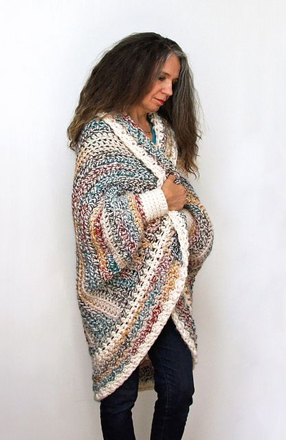 This super comfy oversized sweater shrug fits a range of sizes and features full-length dolman sleeves and an open front. It's easy to crochet and can be made over a weekend.