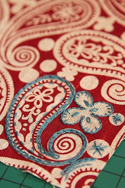Embroidery on printed fabric