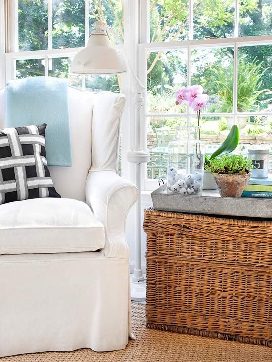 Imaginative Eye-Get creative with repurposing and add storage as well as style to your home. The side table in this sitting room off the kitchen is a woven trunk, which doubles as cleverly concealed storage space. Plus, its woven texture fits right in with the bamboo shades and wicker furniture