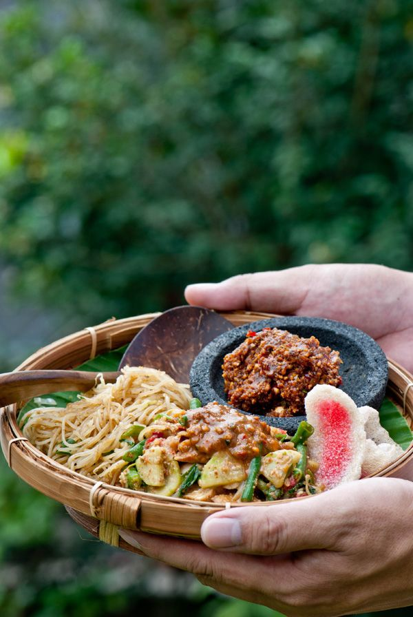 PECEL. ( Indonesian traditional food. an assortment of boiled veggies: spinach, cabbage, bean sprout) topped with peanut sauce ( based on chillies, peanuts, tamarind and coconut sugar). Eat with steamed rice. Additional: fresh basil, cucumber and peanut brittle ).