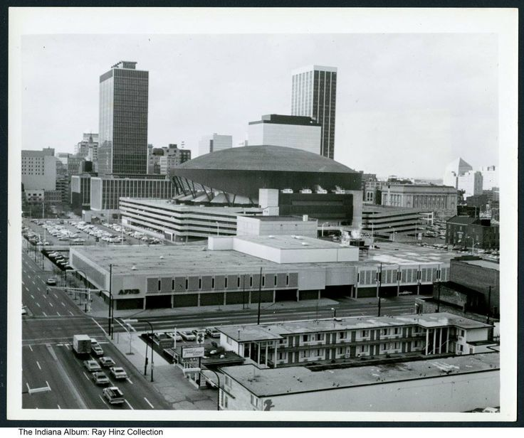 Indianapolis, ca. 1980 - Bird's-eye view of the skyline looking northwest at the intersection of East Washington and East Streets. This area has greatly changed within the past decade.  Visible buildings include: 1. Indianapolis City-County Building (200 East Washington Street) 2. Market Square Arena (300 East Market Street, constructed in 1974 and razed in 2001; currently the site of Cummins Global Distribution Headquarters