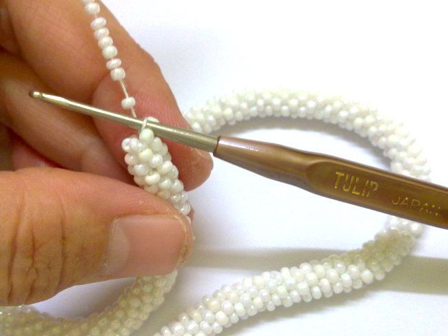 Emily Secret Passions: Crochet Jewelry ~ Beaded Rope Lariat...my great grandma used to do this. i have a necklace she made. maybe one day i'll learn too.