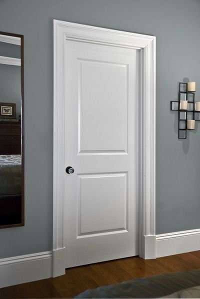 Clean, simple interior door, trim and mouldings and crystal door knobs!