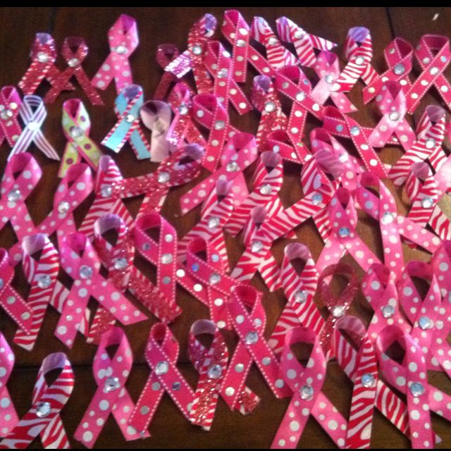 Very easy ribbons I made for a breast cancer benefit. Just some ribbon, pins, fake crystals, and some got glue.