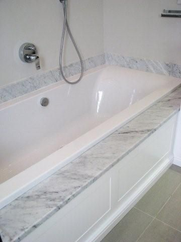 bath with marble & wood panel