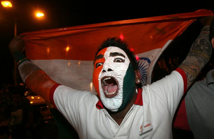 A cricket fan celebrates in Chandigarh, after India won the ICC Cricket World Cup final match against Sri Lanka, on April 2, 2011. India sparked wild celebrations among their billion supporters after beating Sri Lanka by six wickets in the World Cup final at Mumbai's Wankhede Stadium on Saturday. (Reuters/Ajay Verma)