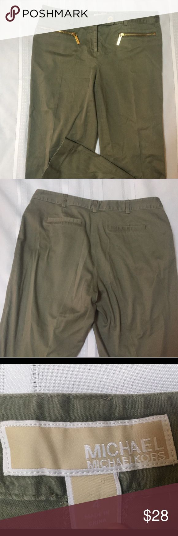 Michael Kors Army Green Slacks Dress Pants Size 4 ❤️ All profits from their purchase will be donated to the victims of the Tubbs fore in Northern California.🚒 These super cute Michael Kors Pants are classy and in style. It has two zippered front pockets and the two back pockets are decoration. It has some small scratches on the front pocket zippers, view pictures, but they are faint and not very noticeable. This is made from 97% Cotton and 3% Spandex. Michael Kors Pants Trousers