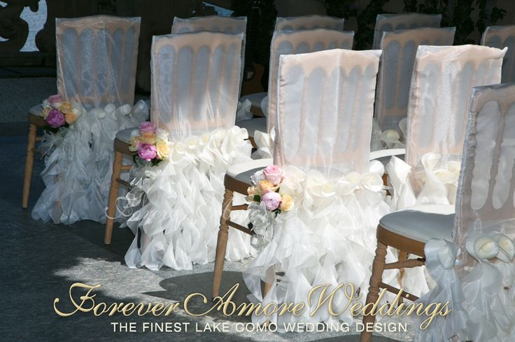Villa Balbianello wedding ceremony. Detail of organza chair sleeves and chair bouquets in the shades of peach, pink and ivory. Picture by ForeverAmoreWeddings ©