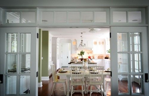 Glass paneled pocket doors create a subtle separation - Doors to separate kitchen from living room ...