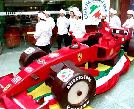 Formula1 Ambitious Italian confectioners spent more than a year creating this life-size replica of a Ferrari race car. The bad news: It is probably no longer around by the time you read this. The good news: 2,000 kg (4,405 lbs) of pure Belgian chocolate was used, instead of the Swiss variety!
