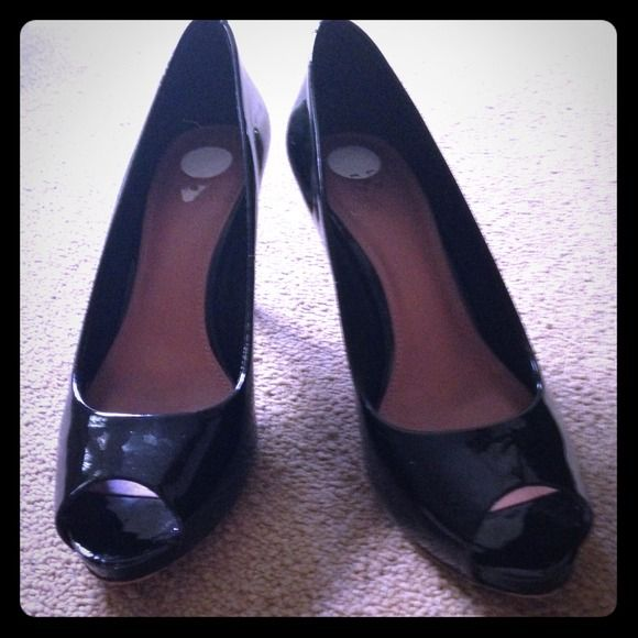 Black Vince camuto peep toe pumps Black Vince camuto peep toe pumps. Used less than 5 times. Vince Camuto Shoes Heels