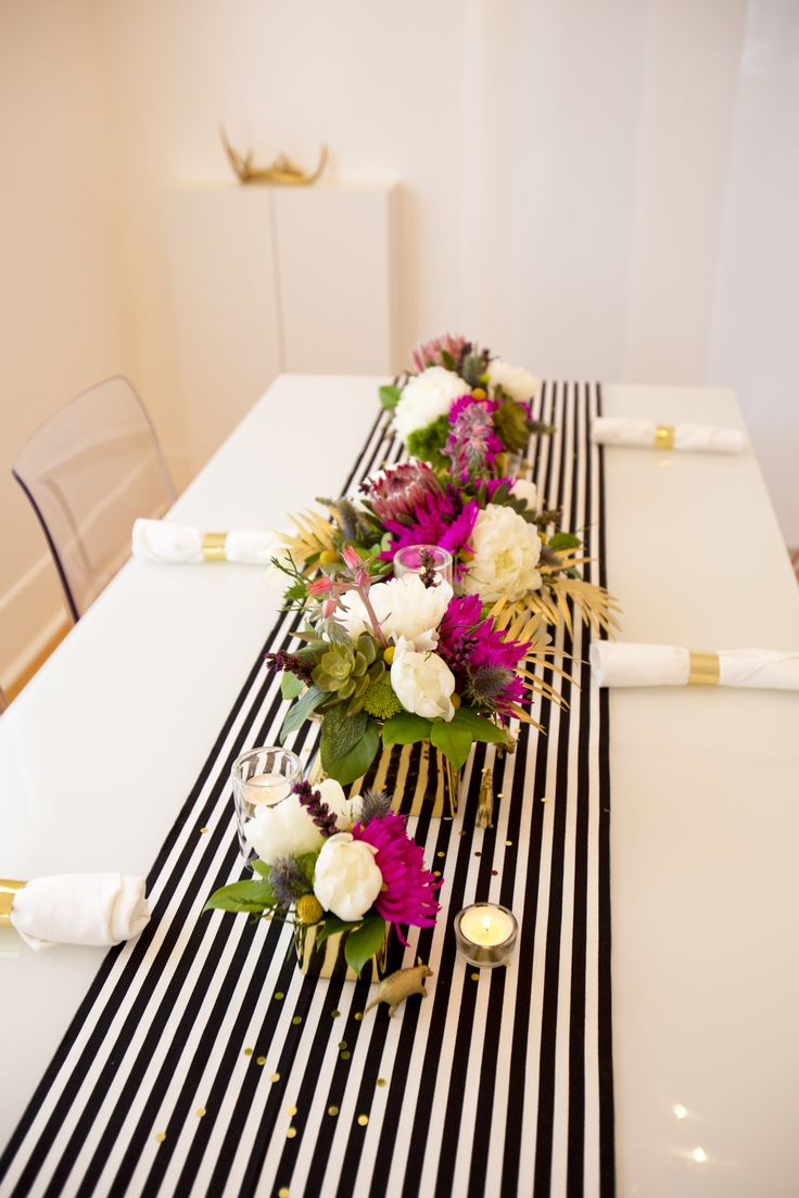 table setting for 27th birthday; black/white & gold with a hint of color