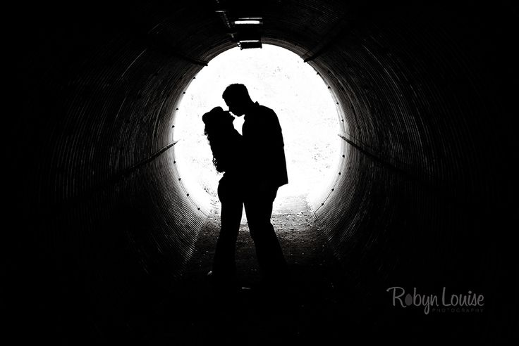 Photos in a tunnel, sillouette.  Quesnel, Williams Lake and Cariboo BC Engagement Photography Photographer.  Available worldwide.  Engagements | Robyn Louise Photography www.robynlouise.com Engagements | Robyn Louise Photography Engagements | Robyn Louise Photography